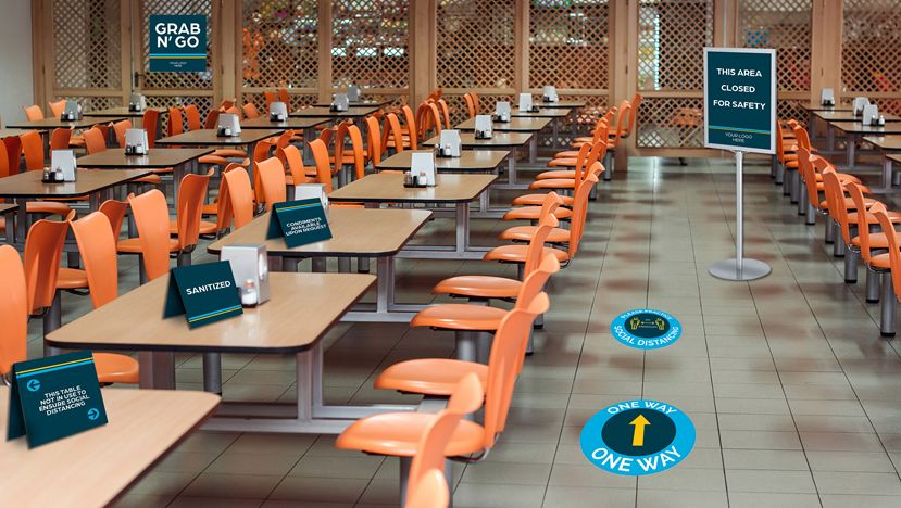 School Cafeteria with Reopening Signs and Graphics